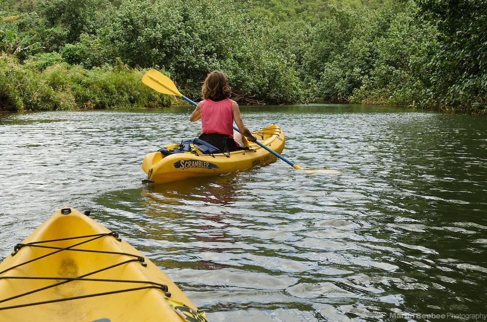 Woman kayaking the Wailua River, Kauai, Hawaii