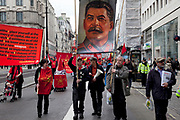 Stalin banner. Demonstration by unions and other organisations of workers to mark the annual May Day or Labour Day. Groups from all nationalities from around the World, living in London gathered to march to a rally in central London, UK.