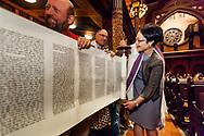 Central Synagogue's senior rabbi Angela Buchdahl unrolls the scroll at a Simchat Torah service
