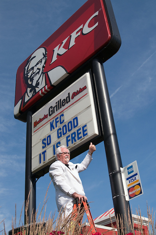 This handout photo from KFC shows the KFC Colonel, Bob Thompson, changing the reader board to say 'KFC So good it is free,' Thursday, June 10, 2010 in Louisville, Ky. KFC's cooking up a free food giveaway for the brand's fans in 50 restaurants across all 50 states on June 17. (Photo by Brian Bohannon).