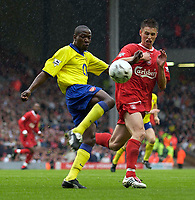 Photo. Jed Wee.<br /> Liverpool v Arsenal, FA Barclaycard Premiership, Anfield, Liverpool. 04/10/03.<br /> Arsenal's Lauren (L) prepares to hook the ball clear from Liverpool's Anthony Le Tallec.