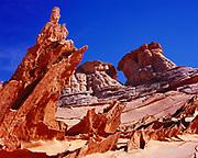 Paper-thin fins of wind-eroded Navajo Sandstone with Navajo Sandstone knolls beyond, Paria Canyon-Vermilion Cliffs Wilderness, Utah.   CB