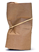 rubber string wrapped around a little paper bag