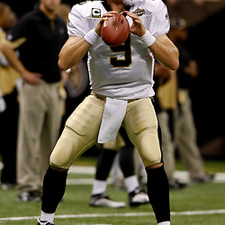September 9, 2010; New Orleans, LA, USA; New Orleans Saints quarterback Drew Brees (9) during warm ups prior to kickoff of the NFL Kickoff season opener at the Louisiana Superdome. The New Orleans Saints defeated the Minnesota Vikings 14-9.  Mandatory Credit: Derick E. Hingle
