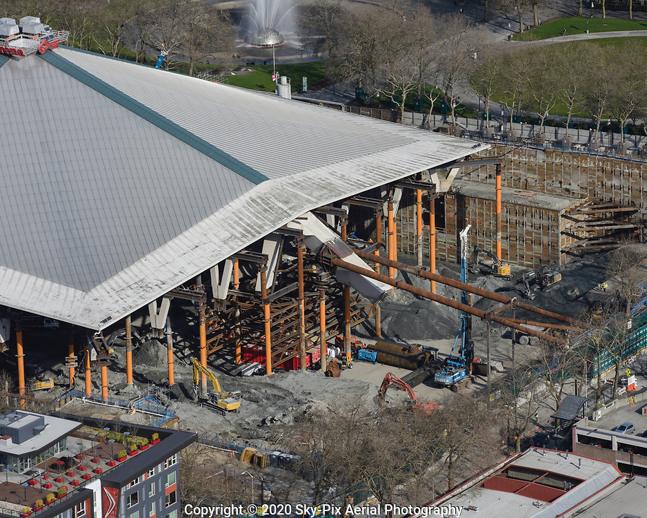 Excavation and shoring work under and around KeyArena at Seattle Center. The landmarked roof of the Seattle Center Arena is being preserved and held by steel supports while demolition and excavation work continues.