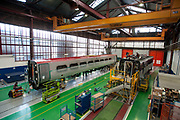 AGV trains for NTV and a Pendolino trains for Virgin are seen at the Alstom SA factory in Savigliano, Italy, on Friday, Feb. 11, 2011. Photographer: Victor Sokolowicz/Bloomberg