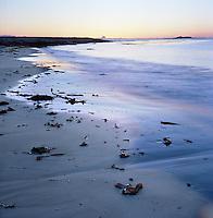 Pastellfarget speilbilde i sjøen av den vakre solnedgangen ved sandstranden på Kvalneset på Giske i Giske kommune.<br /> <br /> Pastel colored reflections in the water during sunset at Kvalneset at Giske.<br /> Foto: Svein Ove Ekornesvåg