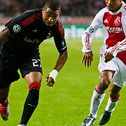 NLD/Amsterdam/20100928 - Champions Leaguewedstrijd Ajax - AC Milan, Urby Emanuelson in duel met Kevin - Prince Boateng
