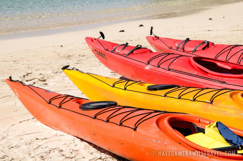 Colorful sea kayaks on the beach at Cruz Bay on St. John in the US Virgin Islands.