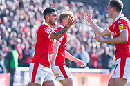 Alex Mowatt of Barnsley (27) scores a goal and celebrates to make the score 1-0 during the EFL Sky Bet League 1 match between Barnsley and Coventry City at Oakwell, Barnsley, England on 30 March 2019.