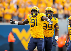 Sep 14, 2019; Morgantown, WV, USA; West Virginia Mountaineers defensive lineman Reuben Jones (91) celebrates after a tackle during the first quarter against the North Carolina State Wolfpack at Mountaineer Field at Milan Puskar Stadium. Mandatory Credit: Ben Queen-USA TODAY Sports