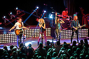 """WASHINGTON, DC - February 14th  2013 - Jimi Westbrook, Kimberly Schlapman, Karen Fairchild and Phillip Sweet of Little Big Town perform at the 9:30 Club in Washington, D.C. The band's 2012 album, """"Tornado,"""" contains the hit single """"Pontoon,"""" which recently won Best Country Duo/Group Performance at the 55th Grammy Awards. (Photo by Kyle Gustafson/For The Washington Post)"""