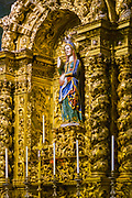 Statue of the pregnant Madonna - Mary Our Lady - in gilded setting in the Cathedral of Evora (Se) in Portugal
