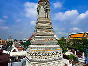 """11 SEPTEMBER 2017 - BANGKOK, THAILAND: Renovations are nearly finished at Wat Arun on the Thonburi side of the Chao Phraya River in Bangkok. Wat Arun is famous for its Khmer style main """"prang"""" (chedi). It was originally built in the Ayutthaya Period and rebuilt to its current form in the time of Rama II.       PHOTO BY JACK KURTZ"""