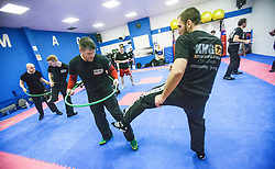 Students kicking and attacking under the inside of the hoop, Stef Noij, KMG Instructor from the Institute Krav Maga Netherlands, at the IKMS G Level Programme seminar today at the Scottish Martial Arts Centre, Alloa.