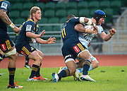 Highlanders player PATRICK OSBORNE (C) tackles LUC BARBA with JOSH RENTON (L) offering support during the Natixis Cup rugby match between French team Racing 92 and New Zealand team Otago Highlanders at Sui San Wan Stadium