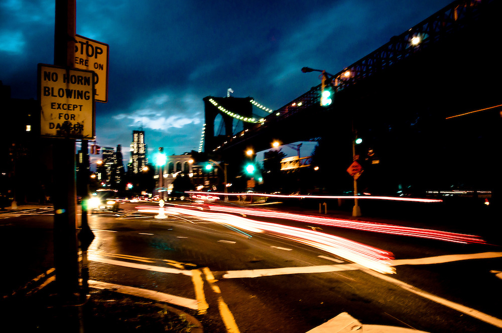 Lights and colors of traffic by the brooklyn brige at night, Brooklyn, New York.