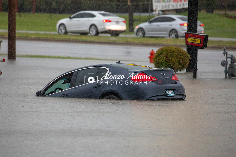 A vehicle is submerged in flood water at I-40 and Reno Ave. in Oklahoma City on Thursday, June 6, 2019. Photo copyright © 2019 Alonzo J. Adams.
