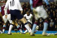 Photograph: Scott Heavey.<br />Tottenham Hotspur v Aston Villa. FA Barclaycard Premiership. 23/11/2003.<br />Rohan Ricketts fires in the equaliser for Spurs