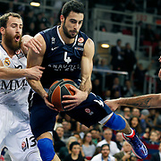 Anadolu Efes's Dogus Balbay (C) and Real Madrid's Sergio Rodriguez (L) during their Turkish Airlines Euroleague Basketball Game 10 match Anadolu Efes between Real Madrid at the Abdi ipekci Arena in Istanbul, Turkey, Thursday, December 19, 2013. Photo by Aykut AKICI/TURKPIX