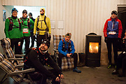 The 50 miles runners get a bit of advice and a pep talk before heading out in the dark to start the run on Hammer harbour.<br /> Salomon Hammer Trail Winter Edition is a first on Bornholm and is one of the toughest routes in Denmark. The 4 runs consist of a 50 mile run, a marathon, a 1/2 marathon and 10k all run a on an approximate 25km route which includes 860 meter vertical rise on the North East coast of the Danish island Bornholm. The cut-off time for the 50mile run was 16 hours and more than a hundred runners made it to the finishing line. The last runner across the line after 50 miles  was in after 15:14:40