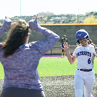 Francesca Chioda, hits a homerun for the Lady Patriots in the bottom of the third inning to tie the game 7-7, Thursday, April 18 against Kirtland Central in Gallup.
