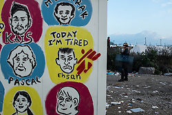 October 25, 2016 - Calais, France - ''Today I am tired'' stand in the Calais Jungle on a container  in Calais, France, on 25 October 2016. Up to the evening, about 4,000 migrants from the Refugee camp on the coast at the English Channel were distributed to several regions in France. The police have begun to tear down the huts and tents in the camp. (Credit Image: © Markus Heine/NurPhoto via ZUMA Press)