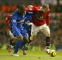 Photo: Aidan Ellis.<br /> Manchester United v Everton. The Barclays Premiership.<br /> 11/12/2005.<br /> Everton's Joseph Yobo battles with United's Wayne Rooney