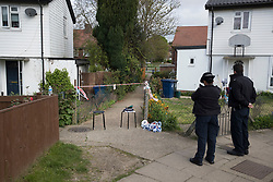 © Licensed to London News Pictures. 12/04/2017. London, UK. Police stand guard at an alleyway off Newnham Close where a 19 year old man, named locally as Abdullahi Tarabai,  was murdered yesterday after reportedly being chased though a housing estate in Northolt. This is the second fatal stabbing in the capital in 24 hours. The location is adjacent to a gun siege from October 2016. Four men have been arrested Photo credit: Peter Macdiarmid/LNP