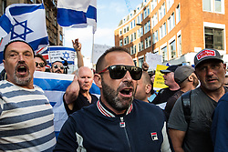 London, UK. 10th June, 2018. Pro-Israel activists holding Israeli flags try to block the pro-Palestinian Al Quds Day march through central London organised by the Islamic Human Rights Commission. An international event, it began in Iran in 1979. Quds is the Arabic name for Jerusalem.