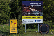 A sign announcing works by Highways England to convert the M4 into a smart motorway is pictured close to Junction 5 on 22nd April 2021 in Langley, United Kingdom. The government has announced that all future all lane running motorways, including any such as the M4 currently being constructed, will require radar technology to detect stopped cars.