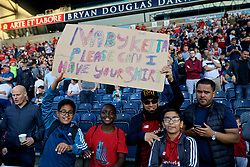 "BLACKBURN, ENGLAND - Thursday, July 19, 2018: Liverpool supporters with a sign ""Naby Keita Please Can I Have Your Shirt"" before a preseason friendly match between Blackburn Rovers FC and Liverpool FC at Ewood Park. (Pic by David Rawcliffe/Propaganda)"