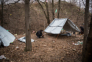 Migrants from Pakistan are seen building a tent with some plastic sheets donated by some volunters, hundreds are living in the wood next to Subotica city center trying to cross the Hungarian border about 10 Km away. Subotica, Serbia, March 18th, 2017. Federico Scoppa