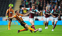 Burnley's Ashley Barnes is tackled by Hull City's James Chester<br /> <br /> Photographer: Chris Vaughan/CameraSport<br /> <br /> Football - Barclays Premiership - Hull City v Burnley - Saturday 9th May 2015 - Kingston Communications Stadium - Hull<br /> <br /> © CameraSport - 43 Linden Ave. Countesthorpe. Leicester. England. LE8 5PG - Tel: +44 (0) 116 277 4147 - admin@camerasport.com - www.camerasport.com