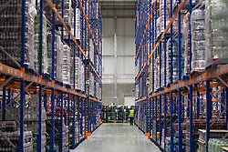 © Licensed to London News Pictures. 25/06/2013. London, UK. A Sainsbury's employee is seen at work in the supermarket chain's newest state of the art logistics centre in Charlton, London, today (25/06/2013). Officially opened today, the logistics centre is currently responsible for supplying around 90 supermarkets in the South East and has so far created 60 jobs on site, with another 1000 to follow in the next three years. Photo credit: Matt Cetti-Roberts/LNP