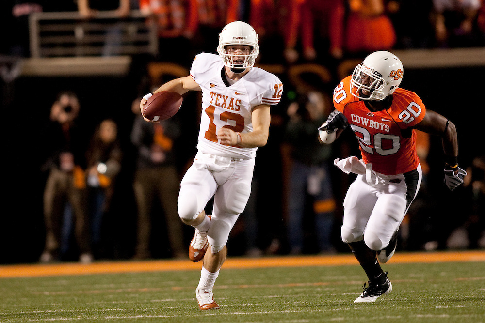 Colt McCoy Quarterback #12. Texas Longhorns at Oklahoma State Cowboys. Photographed at Boone Pickens Stadium in Stillwater, Oklahoma on Saturday, October 31, 2009. Photograph ©  2009 Darren Carroll