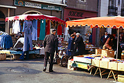 Street traders stall and people in market place at Quimper, Brittany, France in 1974