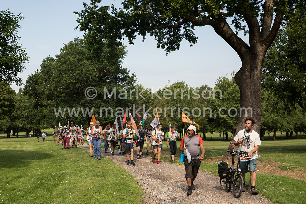 Activists from HS2 Rebellion and Extinction Rebellion UK take part in a 'Rebel Trail' hike along the route of the HS2 high-speed rail link on 26th June 2020 in Denham, United Kingdom. The activists, who departed from Birmingham on 20th June and will arrive outside Parliament in London on 27th June, are protesting against the environmental impact of the high-speed rail link and questioning the viability of the £100bn+ project.