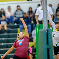 Shiprock Chieftain Lisa Begay (8), left, and Thoreau Hawk Jalena Begay (4) face off at the net at Thoreau High School Thursday.