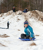 The snow was getting thin but it was still fast and fun as Cecilia Lomanno slides down the sledding hill during Winter Fest at Prescott Farm on Saturday afternoon.  (Karen Bobotas/for the Laconia Daily Sun)