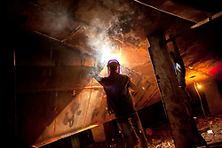 August 2, 2017 - Dhaka, Dhaka, Bangladesh - Laborer welding in a dockyard in the side of Buriganga River. They work in the dockyard without proper safety measures and unsafe conditions. Mostly the Local Ships are built and repair in this place. Ship repair, sewage from the city, oil spills from boats and chemicals from industry have all led to pollution in the Burigonga River. (Credit Image: © K M Asad via ZUMA Wire)