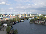 overview of Amsterdam with a typical Dutch canal in the foreground