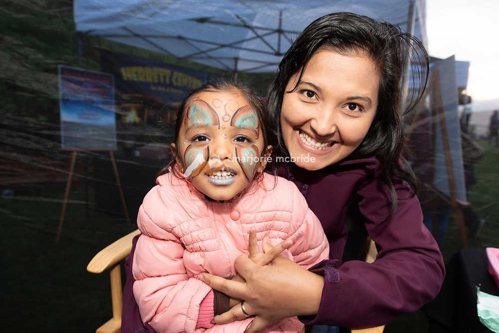 Twin Falls Laser and Lights Show at Shoshone Falls presented by Southern Idaho Tourism and Jayco. Mother holding daughter for face painting.