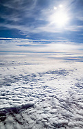 Aerial view of clouds blocking sunlight, part of the role of the atmosphere in regulating earth's climate, © David A. Ponton