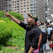Protesters scream at New York City Police officers as they assemble at Foley Square in Lower Manhattan to rally and march due to the killing of George Floyd by a Minnesota Police Officer on Tuesday, June 2, 2020 in Lower Manhattan, New York.  A citywide 8 p.m. curfew was ordered by NY Mayor Bill de Blasio amid the Floyd protests. (Alex Menendez via AP)