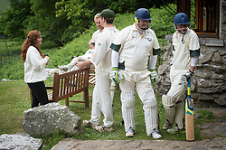 Embargoed to 0001 Monday August 28 Players take a tea break during the annual friendly match between Cravens Cavaliers and Lynton & Lynmouth Cricket Club at the ground based inside the Valley of Rocks, North Devon, on Saturday August 5th, 2017.