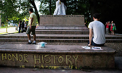 August 17, 2017  People take photos of the pedestal where a statue dedicated to Robert E. Lee and Thomas ''Stonewall'' Jackson stood in Baltimore, Maryland. Four confederate statues were taken down in Baltimore in the early hours of Wednesday, as the city moved swiftly to avoid violent protests similar to the ones Charlottesville had seen over the weekend.  gl) (Credit Image: © Shen Ting/Xinhua via ZUMA Wire)