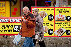 © Licensed to London News Pictures.09/04/2012, Skegness, North Lincolnshire, UK. Bank Holiday Monday weather, Skegness sea front. Some people can`t resist an ice cream even on a chilly Bank Holday Monday. Photo credit : Dave Warren/LNP