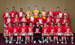 CARDIFF, WALES - Tuesday, March 22, 2011: Wales' players pose for a team group photograph holding Show Racism the Red Card posters at the Vale of Glamorgan Hotel...Back row L-R: Neal Eardley, Lewin Nyatanga, Ashley Williams, goalkeeper Lewis Price, goalkeeper Wayne Hennessey, goalkeeper Boaz Myhill, James Collins, Danny Collins, Neil Taylor...Middle row L-R: Andrew Crofts, Chris Gunter, Andy King, Steve Morison, Sam Vokes, Hal Robson-Kanu, Freddie Eastwood, Joe Allen...Front row L-R: David Vaughan, Daniel Gabbidon, Gareth Bale, Aaron Ramsey, manager Gary Speed MBE, Craig Bellamy, Joe Ledley, Simon Church, Ched Evans...(Photo by David Rawcliffe/Propaganda)