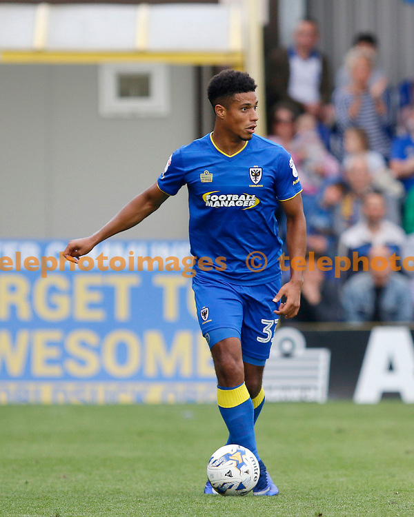 AFC Wimbledon's Lyle Taylor on the ball during the Sky Bet League 1 match between AFC Wimbledon and Shrewsbury Town at the Cherry Red Records Stadium in Kingston. September 24, 2016.<br /> Carlton Myrie / Telephoto Images<br /> +44 7967 642437